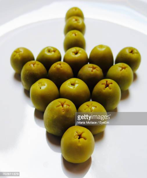 Close-Up Of Olives In Arrow Symbol In Plate
