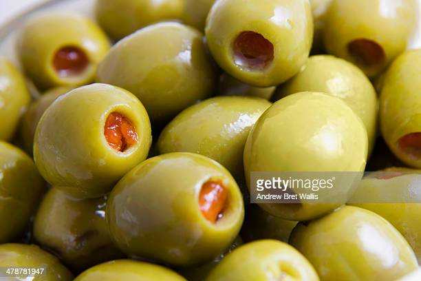 close-up of olives stuffed with pimento - olive pimento stock photos and pictures