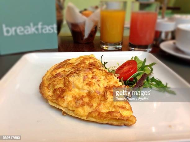 Close-Up Of Omelet With Salad On Plate In Cafe
