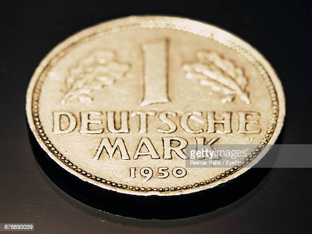 Close-up Of One Deutsche Mark Coin On Table