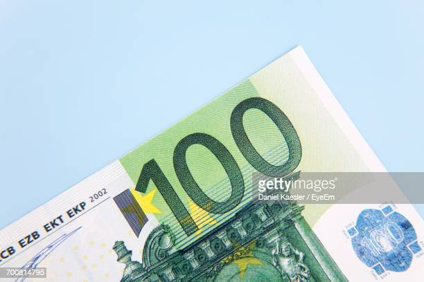 Close-Up Of One Hundred Euro Banknote On Blue Background