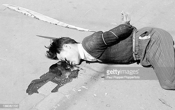 A closeup of one of the executed Chinese prisoners moments after being shot for economic racketeering in Shanghai circa May 1949 Attached to him is a...