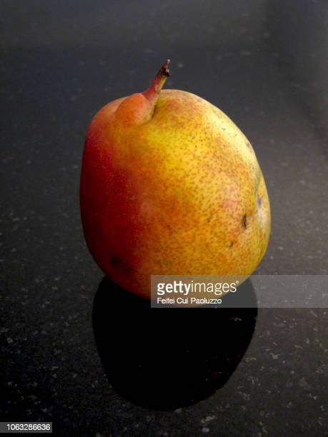 close-up of one pear - imperfection stock pictures, royalty-free photos & images