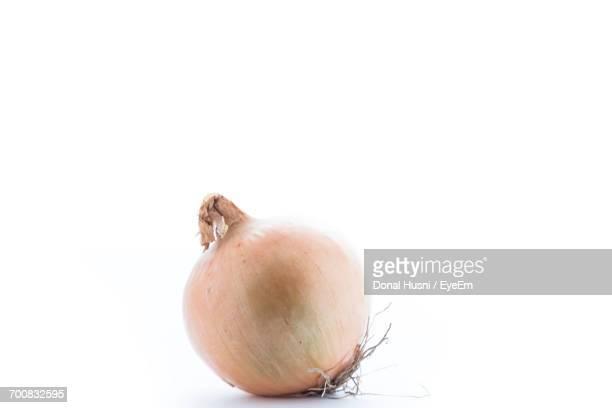 Close-Up Of Onion Against White Background