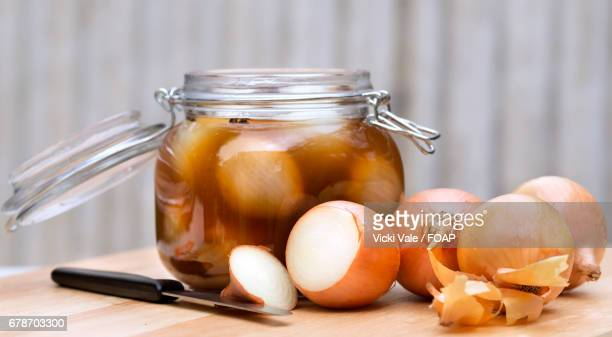 Close-up of onion pickled with kinfe