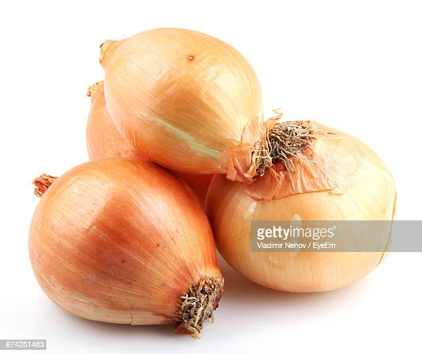 Close-Up Of Onions Against White Background