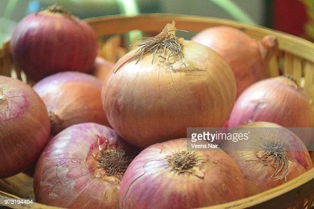 Close-up of onions in a bamboo basket