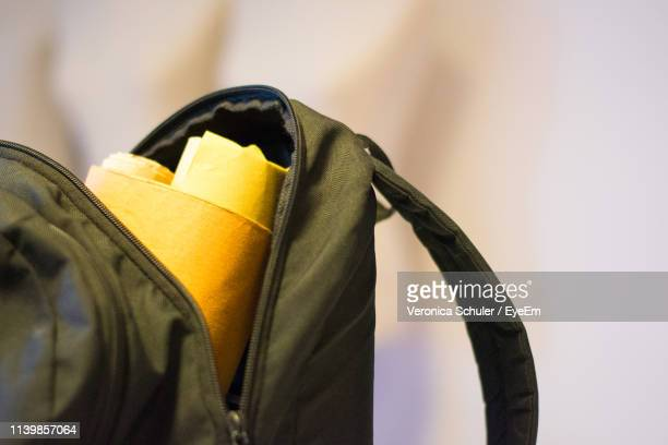 close-up of open backpack against wall - rucksack stock pictures, royalty-free photos & images