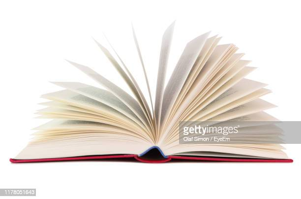 close-up of open book against white background - book stock pictures, royalty-free photos & images