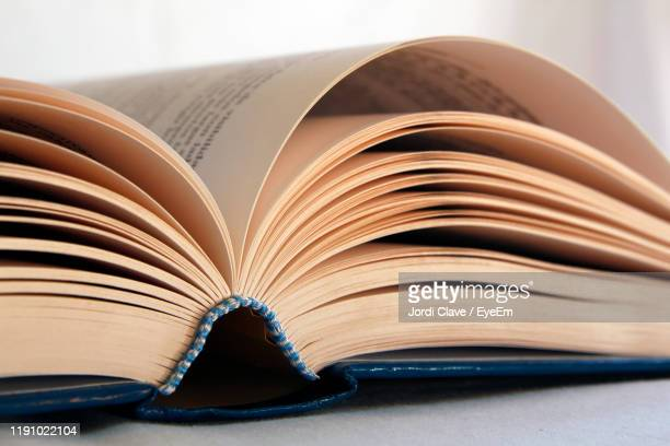 close-up of open book on table - literature stock pictures, royalty-free photos & images