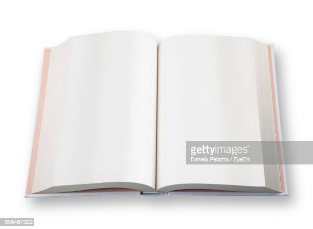 close-up of open book on white background - open book stock photos and pictures