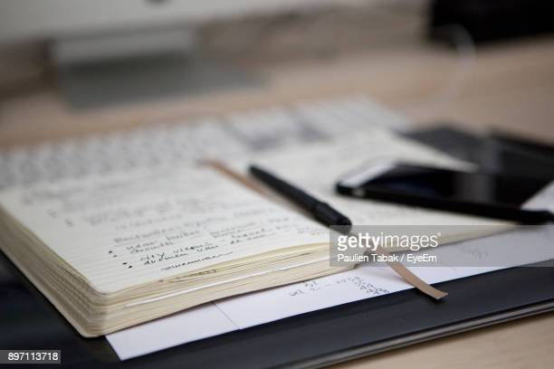 close-up of open book with pen - paulien tabak stock pictures, royalty-free photos & images