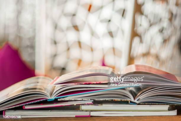 Close-Up Of Open Books On Table