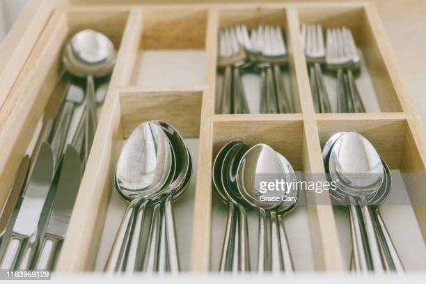 close-up of open cutlery drawer - kitchen utensil stock pictures, royalty-free photos & images