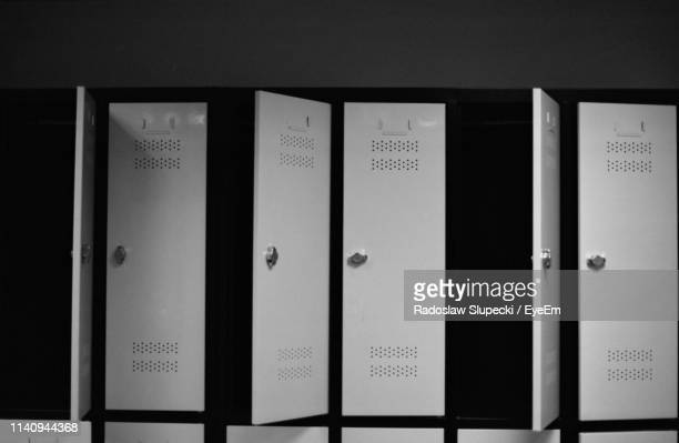 close-up of open doors of locker - locker room stock pictures, royalty-free photos & images