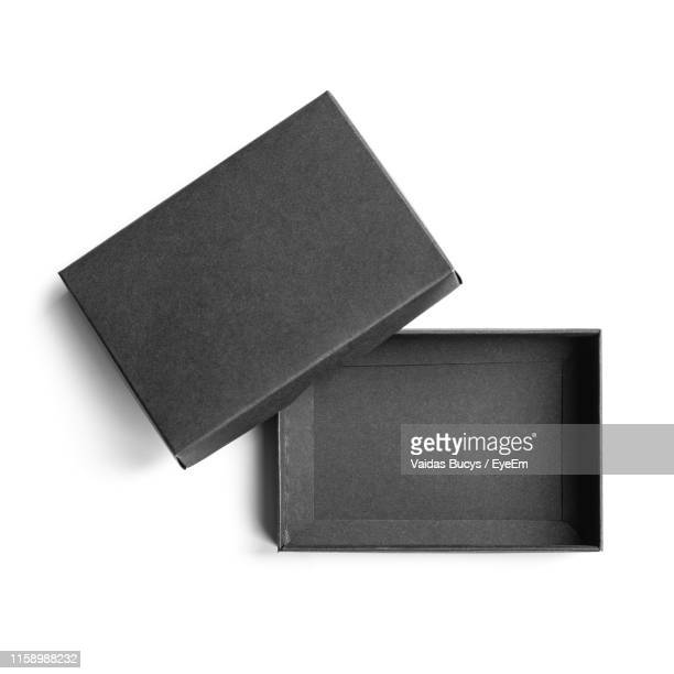 close-up of open empty box against white background - black square stock pictures, royalty-free photos & images