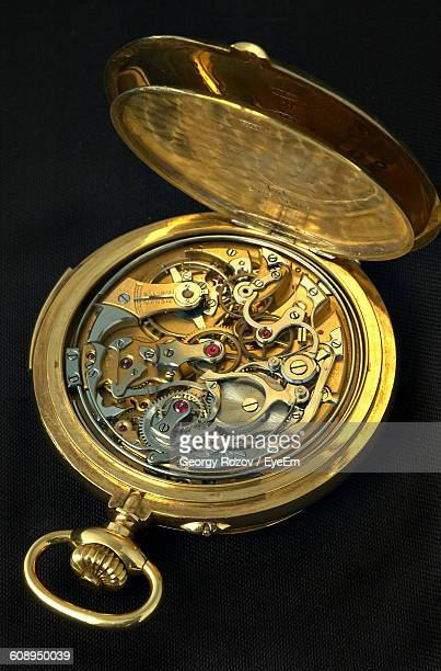 Close-Up Of Open Pocket Watch