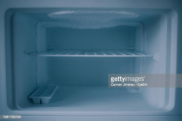 close-up of open refrigerator - empty fridge stock pictures, royalty-free photos & images