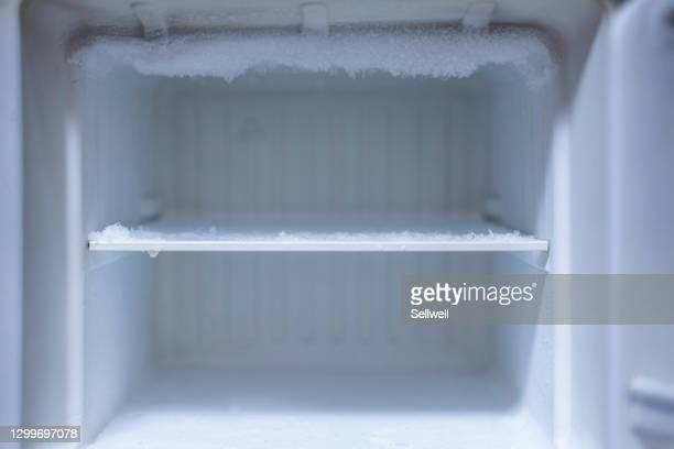 close-up of open refrigerator - 冷凍庫 ストックフォトと画像