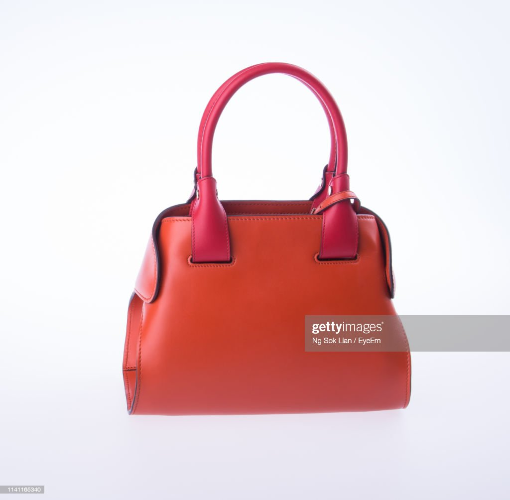 Close-Up Of Orange Bag Against White Background : Stock Photo
