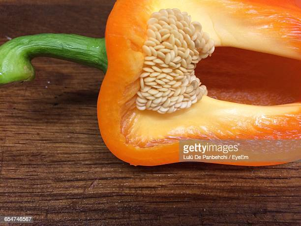 Close-Up Of Orange Bell Pepper On Table