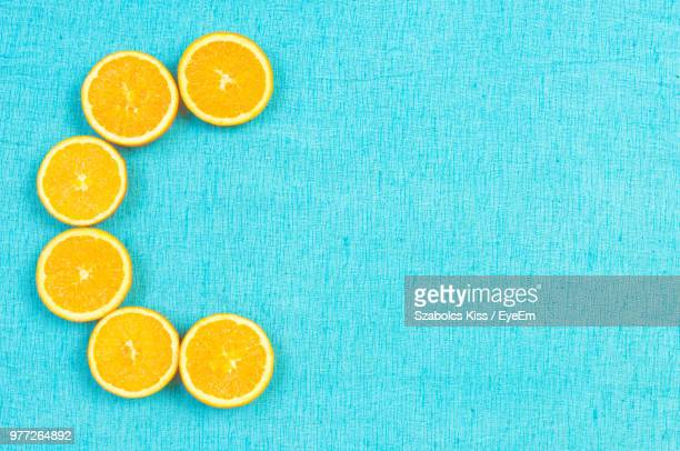 close-up of orange fruits on blue table - vitamin c stock pictures, royalty-free photos & images
