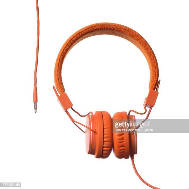Close-Up Of Orange Headphones Over White Background