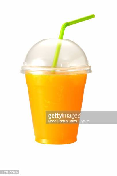 close-up of orange juice against white background - ジュース ストックフォトと画像