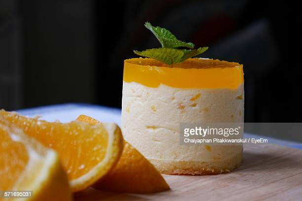 Close-up of orange mousse jelly cake on table