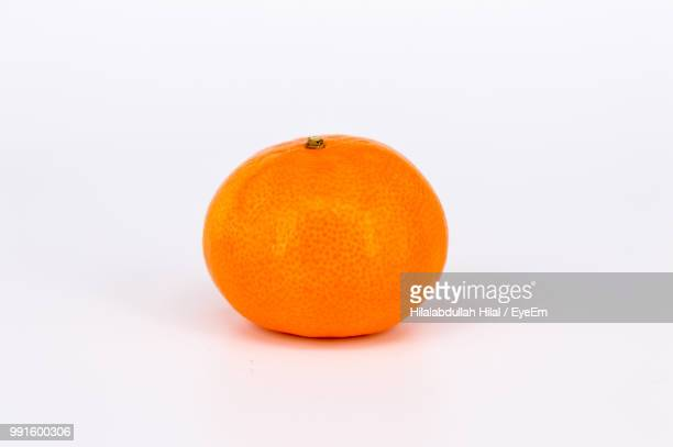 close-up of orange on white background - hilal stock photos and pictures