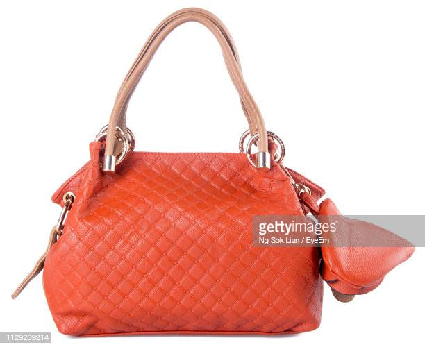 close-up of orange purse over white background - strap stock photos and pictures