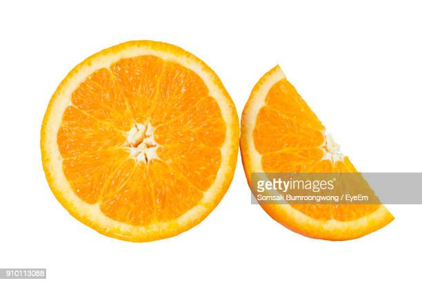 close-up of orange slice against white background - naranja fotografías e imágenes de stock