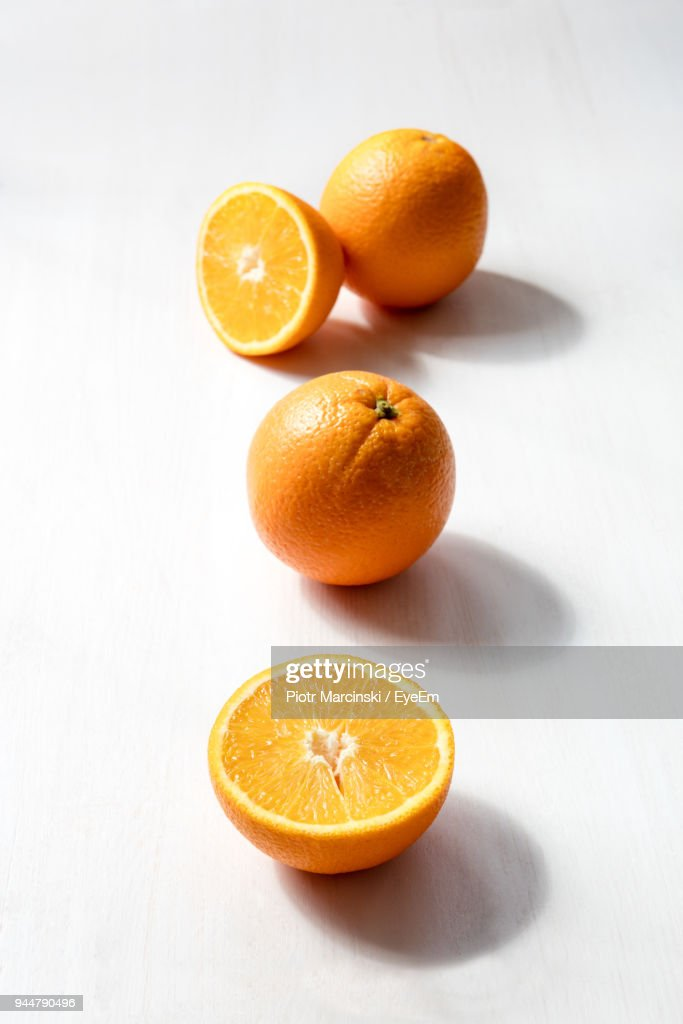 Close-Up Of Orange Slices On Table : Stock Photo