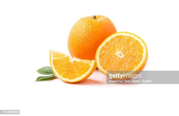 close-up of orange slices on white background - orange imagens e fotografias de stock