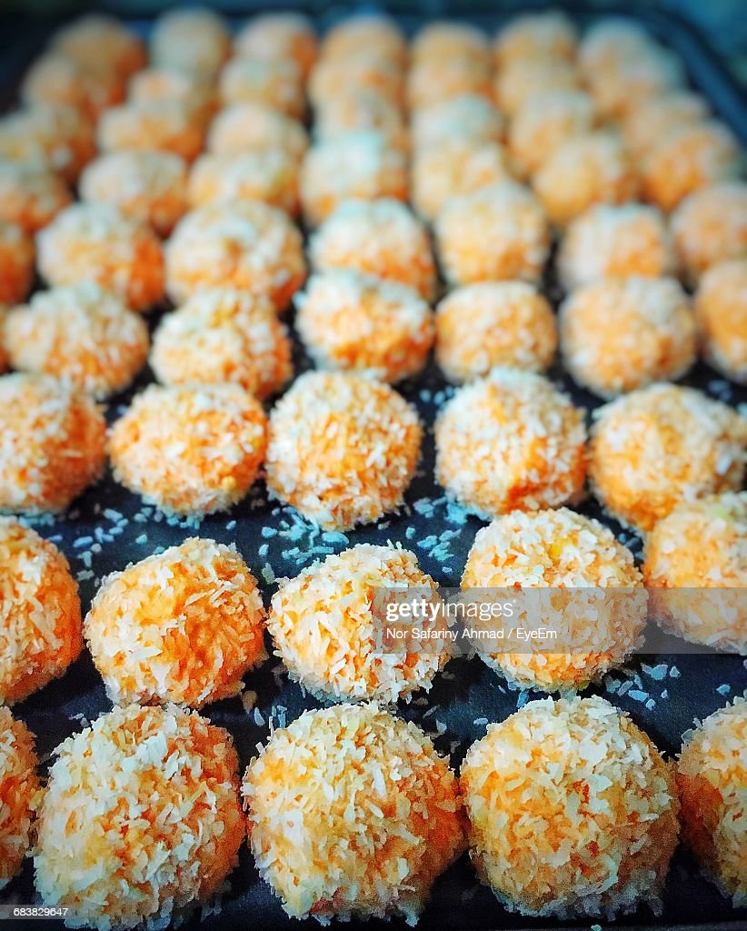 Closeup Of Orange Snowball Cookies At Store Stock Photo Getty Images