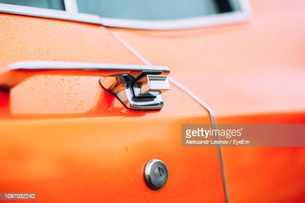 close-up of orange vintage car - handle stock pictures, royalty-free photos & images