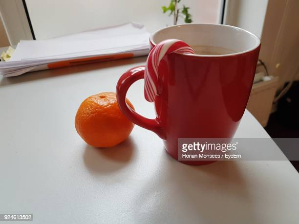 Close-Up Of Orange With Drink On Table