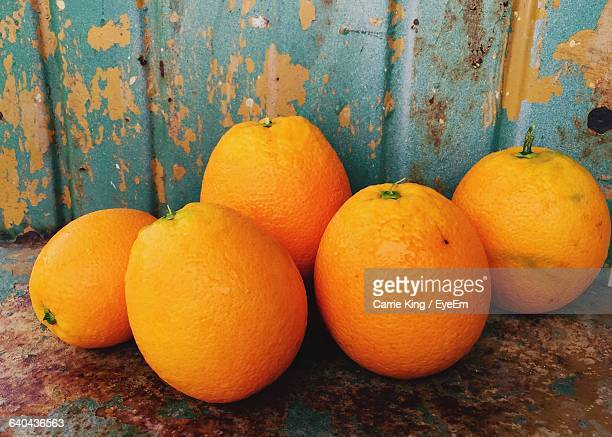 close-up of oranges against rusty metal - el mirage dry lake stock photos and pictures