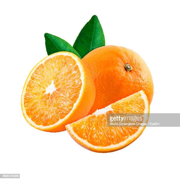 close-up of oranges against white background - oranje stockfoto's en -beelden