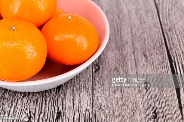 close-up of oranges in bowl on table - hilal stock photos and pictures