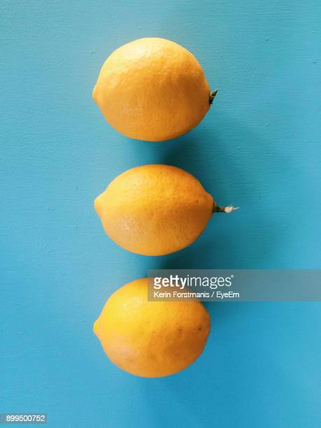 Close-Up Of Oranges On Blue Table