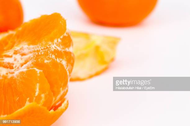 close-up of oranges on white background - hilal stock photos and pictures