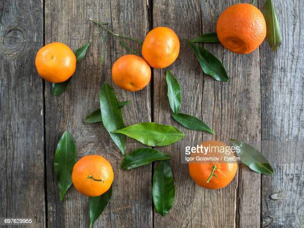 Close-Up Of Oranges On Wood