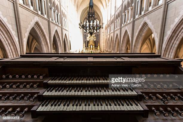 close-up of organ in church - church organ stock pictures, royalty-free photos & images
