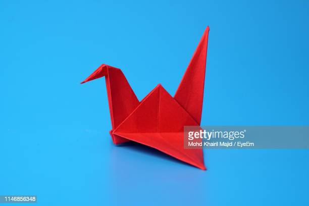 close-up of origami against blue background - origami photos et images de collection