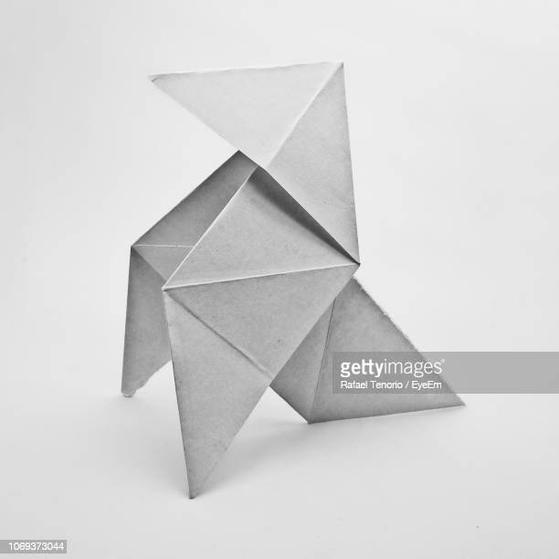 close-up of origami against white background - origami stock pictures, royalty-free photos & images
