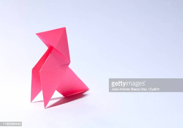 close-up of origami against white background - origami photos et images de collection