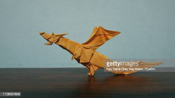 close-up of origami on table - animal representation stock pictures, royalty-free photos & images