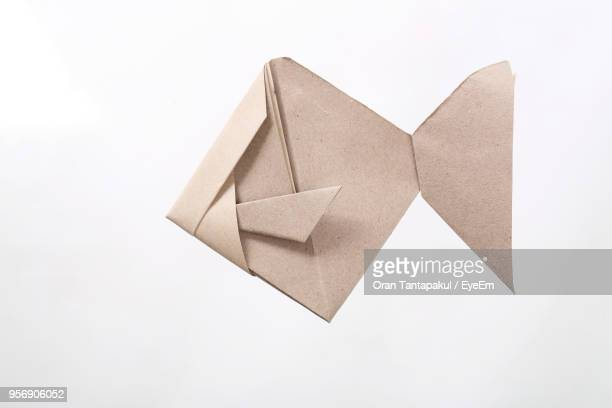 Close-Up Of Origami Over White Background