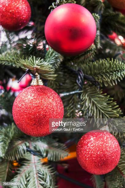 Close-Up Of Ornaments Hanging On Christmas Tree